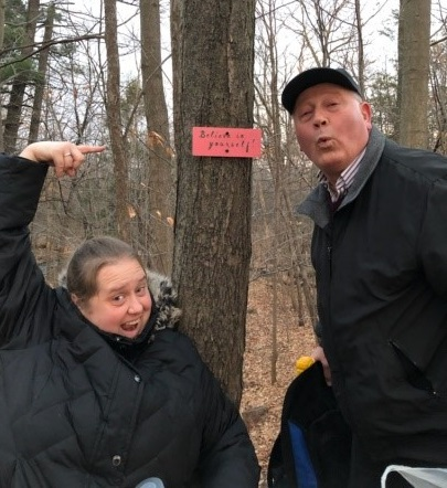 Kathryn and her dad pointing at a sign